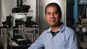 Portrait photo of Venkatesh Murthy in his laboratory