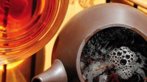 Photo of a steaming pot to tea