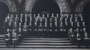 """Formal portrait of the Board of Editors for volume 70 of the """"Harvard Law Review"""" (1956-1957), photographed on the steps of Austin Hall. The author, only the third woman admitted to Review membership, stands in the fourth row, at upper left."""