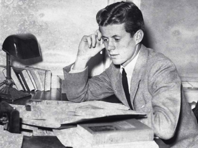 Archival photograph of John F. Kennedy as an undergraduate, circa 1939, studying papers