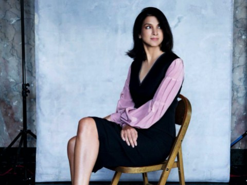 Vanity Fair editor-in-chief Radhika Jones poses stylishly in a studio