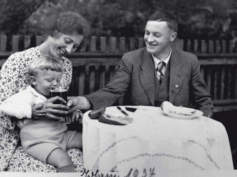 Black-and-white photograph of Karl Puchner in 1937 with his wife, young son, and a tiny, barely visible swastika button on his jacket